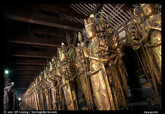Rows of statues of the thousand-armed Kannon (buddhist goddess of mercy), Sanjusangen-do Temple. Kyoto, Japan (color)