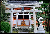 Tori gate at the entrance of a shrine inner grounds. The act of passing through purifies the soul.. Kyoto, Japan