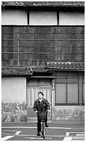 Bicyclist in front of a traditional style house. Kyoto, Japan ( black and white)