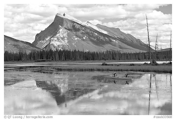 Canoe and Mt Rundle reflection in first Vermillion Lake, afternon. Banff National Park, Canadian Rockies, Alberta, Canada (black and white)