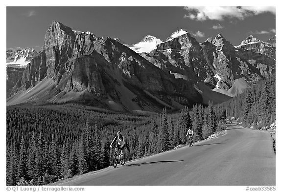 Cyclists on the road to the Valley of Ten Peaks. Banff National Park, Canadian Rockies, Alberta, Canada