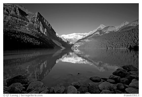 Mountains reflected in Lake Louise, early morning. Banff National Park, Canadian Rockies, Alberta, Canada (black and white)