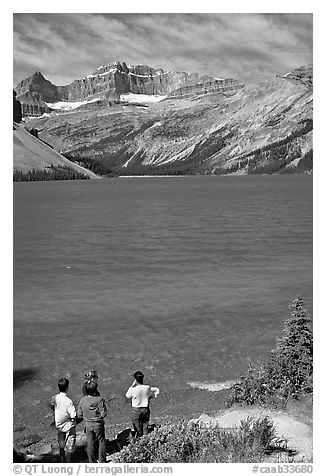 Family standing on the shores of Bow Lake. Banff National Park, Canadian Rockies, Alberta, Canada