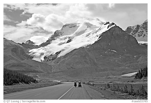Cyclists on the Icefields Parkway at the base of Mt Athabasca. Jasper National Park, Canadian Rockies, Alberta, Canada (black and white)