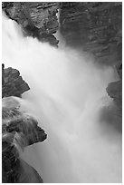 Water cascading over a glacial rock step, Athabasca Falls. Jasper National Park, Canadian Rockies, Alberta, Canada ( black and white)