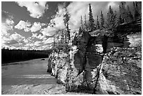Cliff and Athabasca River, late afternoon. Jasper National Park, Canadian Rockies, Alberta, Canada ( black and white)