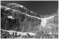 Hikers on a moraine below Mt Edith Cavell, morning. Jasper National Park, Canadian Rockies, Alberta, Canada ( black and white)