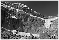 Hiker on a moraine below Mt Edith Cavell and Angel Glacier. Jasper National Park, Canadian Rockies, Alberta, Canada ( black and white)