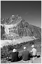 Hikers sitting in front of Mt Edith Cavell next to trail. Jasper National Park, Canadian Rockies, Alberta, Canada ( black and white)
