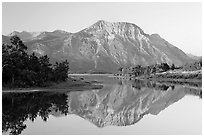 Vimy Peak reflected in Middle Waterton Lake, sunrise. Waterton Lakes National Park, Alberta, Canada ( black and white)