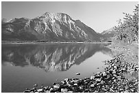 Shoreline with pebbles, Middle Waterton Lake, and Vimy Peak. Waterton Lakes National Park, Alberta, Canada (black and white)