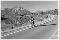 Cyclist next to Lower Waterton Lake. Waterton Lakes National Park, Alberta, Canada ( black and white)