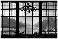 View over Waterton Lake through the windows of Prince of Wales hotel, morning. Waterton Lakes National Park, Alberta, Canada (black and white)
