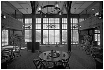Table with view in lobby of Prince of Wales hotel. Waterton Lakes National Park, Alberta, Canada ( black and white)