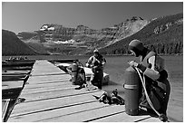 Scuba divers getting ready to dive, Cameron Lake. Waterton Lakes National Park, Alberta, Canada (black and white)