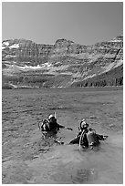 Scuba diving in Cameron Lake, a cold mountain lake. Waterton Lakes National Park, Alberta, Canada ( black and white)