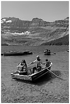 Families boating in Cameron Lake. Waterton Lakes National Park, Alberta, Canada (black and white)
