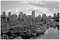 Skyline and small boat harbor. Vancouver, British Columbia, Canada (black and white)