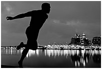 Harry Jerome (a former great sprinter)  statue and Harbor at night. Vancouver, British Columbia, Canada ( black and white)