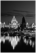 Parliament buildings lights reflected in the harbor. Victoria, British Columbia, Canada ( black and white)