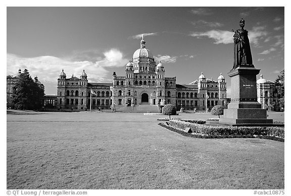 Lawn, statue of Queen Victoria for whom the city was named, and parliament. Victoria, British Columbia, Canada (black and white)