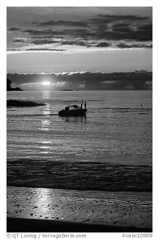 Small boat at Sunset, Half-moon bay. Pacific Rim National Park, Vancouver Island, British Columbia, Canada (black and white)