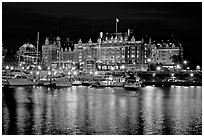 Empress hotel reflected in the Inner Harbour a night. Victoria, British Columbia, Canada (black and white)