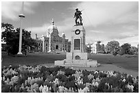 Flowers, memorial, and parliament building. Victoria, British Columbia, Canada ( black and white)
