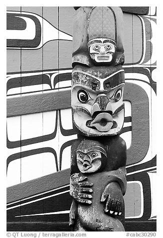 Totem pole and wall of Carving studio. Victoria, British Columbia, Canada (black and white)
