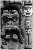 Totem poles in Thunderbird Park. Victoria, British Columbia, Canada ( black and white)