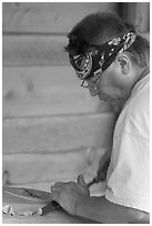 Artist carving a totem pole. Butchart Gardens, Victoria, British Columbia, Canada ( black and white)
