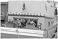 Houseboat decorated with a monkey theme. Victoria, British Columbia, Canada ( black and white)