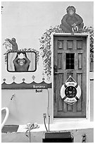 Door of houseboat decorated with a monkey theme. Victoria, British Columbia, Canada ( black and white)