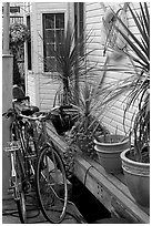 Bicycles, potted plants, and houseboat. Victoria, British Columbia, Canada ( black and white)