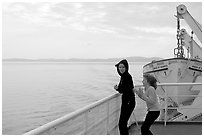 Woman and girl looking out from deck of ferry. Vancouver Island, British Columbia, Canada ( black and white)