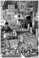 Fruit store in Chinatown. Some of the tropical fruit cannot be imported to the US. Vancouver, British Columbia, Canada ( black and white)