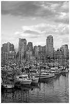 Skyline and boats seen from Fishermans harbor, late afternoon. Vancouver, British Columbia, Canada (black and white)