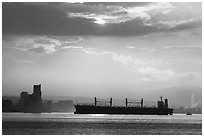 Cargo ship in harbor a sunrise. Vancouver, British Columbia, Canada ( black and white)