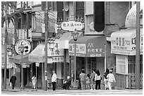 Street in Chinatown with red lamp posts and Chinese characters. Vancouver, British Columbia, Canada ( black and white)