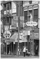 Street in Chinatown with red lamp posts and Chinese script. Vancouver, British Columbia, Canada (black and white)