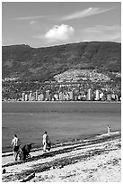 Family near the water on a beach, Stanley Park. Vancouver, British Columbia, Canada (black and white)