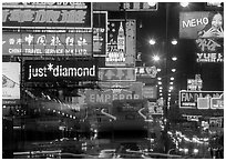 Nathan road, brilliantly lit by neon lights at night, Kowloon. Hong-Kong, China ( black and white)