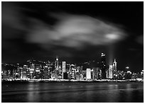 Hong-Kong Island skyline from the waterfront promenade by night. Hong-Kong, China ( black and white)