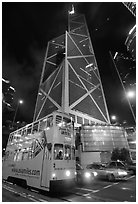 Old tram and Bank of China building (369m), designed by Pei, by night. Hong-Kong, China ( black and white)
