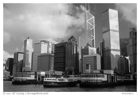Star ferry leaves Hong-Kong island. Symmetrical shape alleviates need for turning around. Hong-Kong, China (black and white)