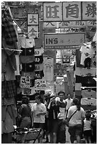 Crowded alley with clothing vendors, Kowloon. Hong-Kong, China ( black and white)