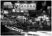 Road with car lights by night, Kowloon. Hong-Kong, China ( black and white)