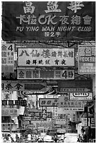 Street filled up with signs in Chinese, Kowloon. Hong-Kong, China ( black and white)