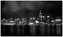 Colorful reflections of Hong-Kong Island lights across the harbor by night. Hong-Kong, China ( black and white)
