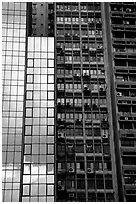 Modern building next to old  building with air conditioners, Hong-Kong Island. Hong-Kong, China ( black and white)